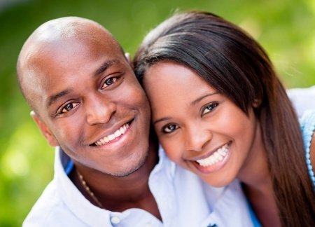 beautiful portrait of a happy couple smiling outdoors