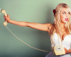 Pop Art Portrait Of A Beautiful Blonde Pin-up Girl On Hold With Call Waiting Music Playing In A Depiction Of Poor Customer Service On Dotted Background